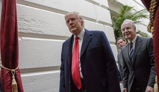 In this March 21, 2017, file photo, President Donald Trump, followed by Health and Human Services Secretary Tom Price, leaves Capitol Hill Washington after rallying support for the Republican health care overhaul with GOP lawmakers. (AP Photo/J. Scott Applewhite, File)