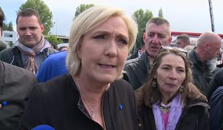 Far-right French presidential candidate Marine Le Pen is greeted by workers outside a whirlpool home appliance factory in Amiens, France, Wednesday April 26, 2017.   While her centrist presidential opponent Macron was meeting with union leaders from the Whirlpool plant in northern France, Le Pen popped up outside the factory itself, amid its workers and declared herself the candidate of France's workers.(AP Photo)