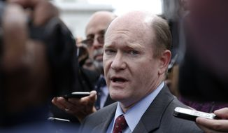 Sen. Chris Coons, D-Del., talks with reporters after an all Senators briefing on the Democratic People's Republic of Korea at the Eisenhower Executive Office Building on the White House complex, Washington, Wednesday, April, 26, 2017. (AP Photo/Carolyn Kaster) ** FILE **