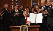 "President Donald Trump holds a signed Antiquities Executive Order during a ceremony at the Interior Department in Washington, Wednesday, April, 26, 2017. The president is asking for a review of the designation of tens of millions of acres of land as ""national monuments."" (AP Photo/Carolyn Kaster)"