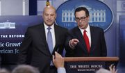 Treasury Secretary Steven Mnuchin, right, joined by National Economic Director Gary Cohn, speaks in the briefing room of the White House, in Washington, Wednesday, April 26, 2017. President Donald Trump is proposing dramatically reducing the taxes paid by corporations big and small in an overhaul his administration says will spur economic growth and bring jobs and prosperity to the middle class. (AP Photo/Carolyn Kaster)