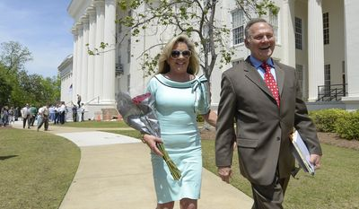 Suspended  Alabama Chief Justice Roy Moore and his wife Kayla, leave a press conference where he announced he planned to run for U.S. Senate, Wednesday, April 26, 2017, on the steps of the Capitol in Montgomery, Ala. The fiery Republican jurist, who was suspended from the bench on accusations that he urged defiance of the landmark U.S. Supreme Court decision allowing gays and lesbians to marry, is running for the U.S. Senate seat previously held by Attorney General Jeff Sessions.  (Julie Bennett/AL.com via AP)