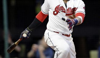 Cleveland Indians' Carlos Santana watches his two-run double off Houston Astros relief pitcher Michael Feliz during the sixth inning of a baseball game, Wednesday, April 26, 2017, in Cleveland. (AP Photo/Tony Dejak)