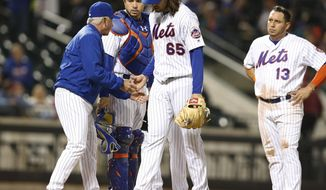 New York Mets manager Terry Collins, left, takes the ball from starting pitcher Robert Gsellman as catcher Travis d'Arnaud and shortstop Asdrubal Cabrera (13) watch from the mound during the fifth inning of the team's baseball game against the Atlanta Braves, Wednesday, April 26, 2017, in New York. (AP Photo/Kathy Willens)