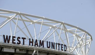 """FILE - In this April 8, 2017 file photo, shows a general view of London Stadium in London. British authorities arrested several men working in professional soccer on suspicion of tax fraud on Wednesday April 26, 2017, in a far-reaching case that saw raids in England and France. Premier League club West Ham said it was """"cooperating"""" with the tax agency """"to assist their enquiries."""" (John Walton/PA via AP, File)"""