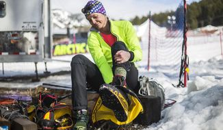 In a March 22, 2017 photo, Ellen Gallant changes out from her new mountaineering boots, following an afternoon of hill repeats on Snow King Mountain in Jackson, Wyo. The boots feature a built-in heating system for sub-zero temperatures at the summit of the 29,029-foot peak.,Gallant is training to return to Mount Everest for third climb  (Ryan Dorgan/Jackson Hole News & Guide via AP)