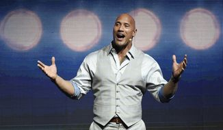 "Dwayne Johnson, a cast member in the upcoming film ""Baywatch,"" addresses the audience during the Paramount Pictures presentation at CinemaCon 2017 in Las Vegas, March 28, 2017. (Photo by Chris Pizzello/Invision/AP) ** FILE **"