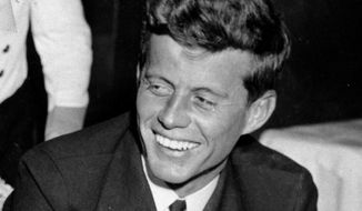 FILE - In this Feb. 9, 1944, file photo, U.S. Navy Lt. John F. Kennedy smiles at the Stork Club in New York. A diary written by Kennedy in 1945 during his brief stint as a journalist after World War II is being auctioned on April 26, 2017, by RR Auction in Boston. (AP Photo/File)