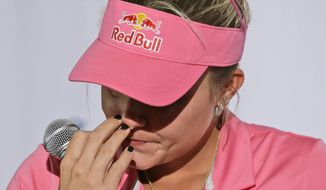 Lexi Thompson pauses after becoming emotional while speaking to reporters about her recent tournament loss Wednesday, April 26, 2017, in Irving, Texas. Thompson suffered a four-stroke penalty that cost her a major earlier this month after a spectator called in to point out the infraction. (AP Photo/LM Otero)