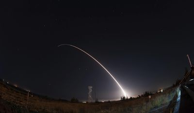 In this image taken with a slow shutter speed and provided by the U.S. Air Force, an unarmed Minuteman 3 intercontinental ballistic missile launches during an operational test early Wednesday, April 26, 201,  from Vandenberg Air Force Base, Calif. The target of the test was in the Pacific Ocean. An Air Force statement said the mission was part of a program to test the effectiveness, readiness, and accuracy of the weapon system. (Michael Peterson/U.S. Air Force via AP)