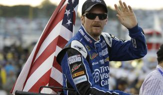 FILE - In this Sept. 7, 2013, file photo, Dale Earnhardt Jr. waves to the crowd during driver introductions for a NASCAR Sprint Cup Series auto race at Richmond International Raceway in Richmond, Va. First went Jeff Gordon. Then Tony Stewart. Now Dale Earnhardt Jr. is packing his bags to leave NASCAR. All have their own reasons, but the nation's most popular auto racing series is a victim of its own popularity.  (AP Photo/Steve Helber, File)
