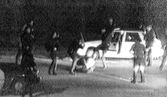 FILE - This March 3, 1991 image made from video provided by KTLA Los Angeles shows police officers beating Rodney King. King was pulled over by California Highway Patrol officers for speeding on a Los Angeles freeway. King, who later admitted he tried to elude authorities because he had been drinking and was on probation for a robbery conviction, pulled off the freeway and eventually stopped his car in front of a San Fernando Valley apartment building. At that point, Los Angeles police officers took charge of the traffic stop. George Holliday, who lived in the apartment building and was awakened by the noise, came out to videotape the scene. After Holliday turned the video over to a local TV station, it quickly spread and created an international outrage. (George Holliday/KTLA Los Angeles via AP)