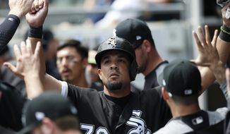 Chicago White Sox's Jose Abreu celebrates with teammates after scoring on a double by Todd Frazier during the first inning of a baseball game against the Kansas City Royals, Wednesday, April 26, 2017, in Chicago. (AP Photo/Nam Y. Huh)