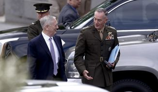 Defense Secretary Jim Mattis and Joint Chiefs Chairman Gen. Joseph Dunford talks as they walk from an all Senators briefing on the situation in the Koreas, Wednesday, April 26, 2017, at the Eisenhower Executive Office Building on the White House complex in Washington. (AP Photo/Carolyn Kaster) ** FILE **