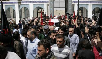 In this photo released by the Syrian official news agency SANA, mourners carry the coffins of more than 50 people  killed in a recent car bomb attack that targeted government supporters being evacuated from a besieged area, during their funeral at the Sayida Zeinab suburb of Damascus, Syria, Wednesday, April 26, 2017. Wednesday's procession took place in a Damascus suburb that is home to a major Shiite shrine and is a stronghold for Hezbollah, the Lebanese militant group fighting alongside the Syrian government. The April 15 attack killed nearly 130 people, including over 60 children. (SANA via AP)