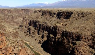 """FILE--This March 25, 2013, file aerial photograph shows the Rio Grande Gorge, looking north from the Taos Gorge Bridge, which is now part of the Rio Grande del Norte National Monument near Taos, N.M. President Donald Trump signed an executive order Wednesday, April 26, 2017, directing his interior secretary to review the designation of dozens of national monuments on federal lands, as he singled out """"a massive federal land grab"""" by the Obama administration. (Dean Hanson/The Albuquerque Journal via AP, file)"""