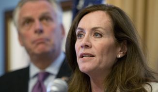 Dorothy McAuliffe, wife of Virginia Gov. Terry McAuliffe (left), speaks during a news conference at the Capitol in Richmond, Va., on Jan. 10, 2017. (Associated Press) **FILE**