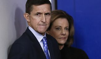 "FILE - In this Feb. 1, 2017 file photo, then-National Security Adviser Michael Flynn, joined by K.T. McFarland, deputy national security adviser, watches the daily news briefing at the White House in Washington. Documents released by lawmakers show Flynn, now former national security adviser, was warned when he retired from the military in 2014 not to take foreign money without ""advance approval"" by Pentagon authorities.  (AP Photo/Carolyn Kaster, File)"
