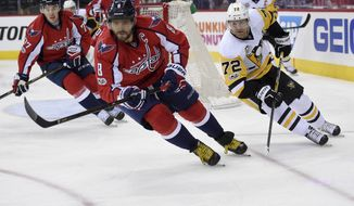 Washington Capitals left wing Alex Ovechkin (8), of Russia, chases the puck against Pittsburgh Penguins right wing Patric Hornqvist (72), of Sweden, during Game 1 of an NHL hockey Stanley Cup second-round playoff series, Thursday, April 27, 2017, in Washington. (AP Photo/Nick Wass)