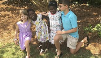 This April 15, 2017 photo provided by the family shows the four children of Josh and Laura Beth Christian in their hometown of Greenville, S.C.. From left are Emme Sue, 8; Tula, 4; Lola, 6, and Camden, 11. Tula and Lola were adopted from Uganda in 2017, although the process was delayed after the U.S. State Department shut down European Adoption Consultants, the adoption agency that the Christians had been using. The agency was accused of extensive improprieties in its operations. (Josh Christian via AP)
