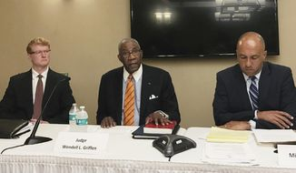 Pulaski County Circuit Judge Wendell Griffen, center, speaks at a news conference Wednesday, April 26, 2017, with his attorneys about a letter he's sent to two panels seeking an investigation into Arkansas' attorney general and Supreme Court over his removal from hearing death penalty cases. Griffen was removed from the cases after he participated in an anti-death penalty demonstration the same day he blocked Arkansas from using a lethal injection drug. (AP Photo/Andrew DeMillo)