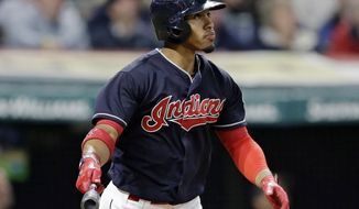 Cleveland Indians' Francisco Lindor watches his two-run home run off Houston Astros relief pitcher Chris Devenski during the seventh inning of a baseball game, Thursday, April 27, 2017, in Cleveland. (AP Photo/Tony Dejak)