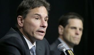 Boston Bruins head coach Bruce Cassidy, left, takes questions from reporters as general manager Don Sweeney, right, looks on during a news conference, Thursday, April 27, 2017, in Boston. The NHL hockey club are bringing Bruce Cassidy back next season, dropping the interim tag from his title as a reward for leading the team back to the playoffs for the first time in three seasons. (AP Photo/Steven Senne)