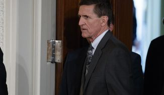 """FILE - In this Feb. 13, 2017 file photo, Mike Flynn arrives for a news conference in the East Room of the White House in Washington. Documents released by lawmakers show Flynn, now former national security adviser, was warned when he retired from the military in 2014 not to take foreign money without """"advance approval"""" by Pentagon authorities.  (AP Photo/Evan Vucci, File)"""