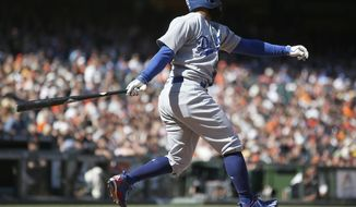 Los Angeles Dodgers' Andrew Toles watches an RBI single against the San Francisco Giants during the 10th inning of a baseball game in San Francisco, Thursday, April 27, 2017. (AP Photo/ Tony Avelar)
