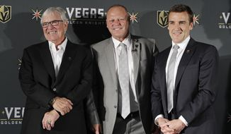 FILE - In this April 13, 2017, file photo, Vegas Golden Knights coach Gerard Gallant is flanked by Bill Foley, left, owner of the Vegas Golden Knights, and George McPhee, Vegas Golden Knights general manager, in Las Vegas. Vegas Golden Knights general manager George McPhee certainly wouldn't mind some Lady Luck to rub off on his NHL expansion franchise when it comes to how the balls drop in the league's draft lottery on Saturday.  (AP Photo/John Locher, File)