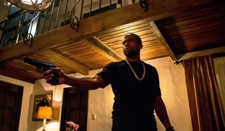 """This image released by WWE Studios shows Dule Hill in a scene from, """"Sleight."""" (WWE Studios via AP)"""