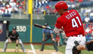 Philadelphia Phillies' Brock Stassi connects for an RBI double scoring Michael Saunders during the sixth inning of a baseball game against the Miami Marlins, Thursday, April 27, 2017, in Philadelphia. (AP Photo/Tom Mihalek)