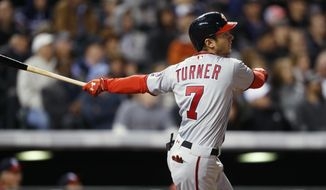 Washington Nationals' Trea Turner watches his solo home run off Colorado Rockies starting pitcher Tyler Chatwood during the fifth inning of a baseball game Wednesday, April 26, 2017, in Denver. (AP Photo/David Zalubowski)