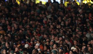 Fans gather to watch the first round of the 2017 NFL football draft, Thursday, April 27, 2017, in Philadelphia. (AP Photo/Julio Cortez)