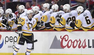 Pittsburgh Penguins center Sidney Crosby (87) celebrates his goal with the bench during the second period of Game 1 of the team's NHL hockey Stanley Cup second-round playoff series against the Washington Capitals, Thursday, April 27, 2017, in Washington. (AP Photo/Nick Wass)