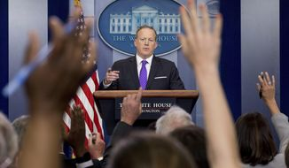 White House press secretary Sean Spicer calls on a member of the media during the daily press briefing at the White House in Washington, Thursday, April 27, 2017. Spicer discussed former National Security Adviser Michael Flynn, Trump's tax overhaul plan and other topics. (AP Photo/Andrew Harnik)