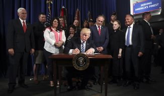 """President Donald Trump signs an Executive Order on """"Improving Accountability and Whistleblower Protection"""" at the Department of Veterans Affairs, Thursday, April 27, 2017, in Washington. (AP Photo/Andrew Harnik)"""