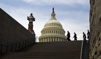 In this photo taken April 27, 2017, people walk outside of the U.S. Capitol, on a warm and humid day, as Congress continues work on keeping the federal government open. With neither party savoring a federal shutdown, it seemed likely Congress would approve the week-long stopgap measure in time to keep agencies open. (AP Photo/Jose Luis Magana)