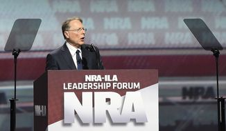 National Rifle Association Executive Vice President Wayne LaPierre speaks ahead of President Donald Trump during the National Rifle Association-ILA Leadership Forum, Friday, April 28, 2017, in Atlanta. The NRA is holding its 146th annual meetings and exhibits forum at the Georgia World Congress Center. (AP Photo/Mike Stewart)