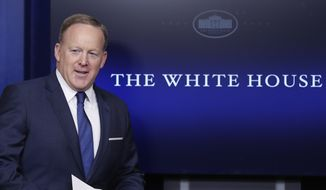 White House press secretary Sean Spicer arrives in the briefing room of the White House, in Washington, Wednesday, April 26, 2017. (AP Photo/Carolyn Kaster) ** FILE **