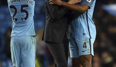 Manchester City's Fernandinho, from left, Manchester City's manager Pep Guardiola and Manchester City's Vincent Kompany react after the English Premier League soccer match between Manchester City and Manchester United at the Etihad Stadium in Manchester, England,Thursday, April 27, 2017.(AP Photo/Dave Thompson)