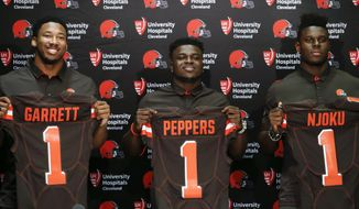 The Cleveland Browns first round draft choices, from left, Myles Garrett, Jabrill Peppers, and David Njoku pose for pictures during an NFL football news conference at the team's training facility, Friday, April 28, 2017, in Berea, Ohio. (AP Photo/Ron Schwane)