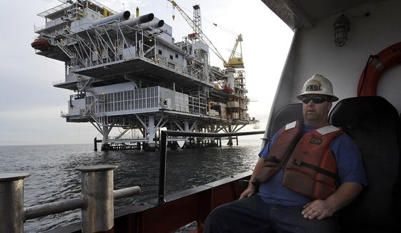 """FILE - In this May 1, 2009 file photo, a crew member arrives by boat at the offshore oil drilling platform """"Gail"""", operated by Venoco, Inc., off the coast near Santa Barbara, Calif. Leaders in the California Senate say they are introducing legislation to thwart President Donald Trump's attempts to expand offshore drilling through an executive order he signed Friday, April 28, 2017. (AP Photo/Chris Carlson, File)"""
