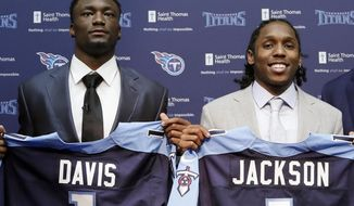 Western Michigan wide receiver Corey Davis, left, and Southern California defensive back Adoree' Jackson pose for photos as they are introduced as the Titans' top draft picks during a news conference Friday, April 28, 2017, in Nashville, Tenn. (AP Photo/Mark Humphrey)