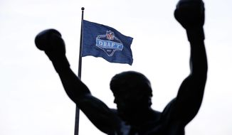 An NFL Draft flag flies near the Rocky statue during the second round of the 2017 NFL football draft, Friday, April 28, 2017, in Philadelphia. (AP Photo/Matt Rourke)
