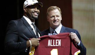 Alabama's Jonathan Allen, left, poses with NFL commissioner Roger Goodell after being selected by the Washington Redskins during the first round of the 2017 NFL football draft, Thursday, April 27, 2017, in Philadelphia. (AP Photo/Julio Cortez)