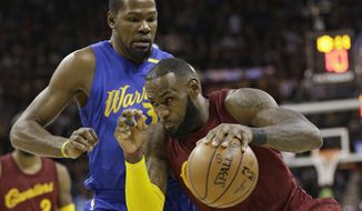 FILE - In this Dec. 25, 2016, file photo, Cleveland Cavaliers' LeBron James (23) drives past Golden State Warriors' Kevin Durant (35) in the first half of an NBA basketball game, in Cleveland. From Cleveland to Oakland, the two star-studded teams expected to rematch once more in the NBA Finals have ample time to rest up, get healthy and prepare for the next opponent. (AP Photo/Tony Dejak, File)