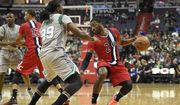 John Wall, with ball, and Jae Crowder have a feisty on-court history. / AP images