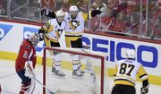 Pittsburgh Penguins right wing Phil Kessel (81) celebrates his goal with center Jake Guentzel (59) and Sidney Crosby (87) during the third period of Game 2 in an NHL hockey Stanley Cup second-round playoff series against Washington Capitals goalie Philipp Grubauer (31), of Germany, Saturday, April 29, 2017, in Washington. (AP Photo/Nick Wass)