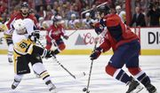 Pittsburgh Penguins right wing Phil Kessel (81) shoots the puck against Washington Capitals defenseman Kevin Shattenkirk (22) during the first period of Game 2 in an NHL hockey Stanley Cup second-round playoff series, Saturday, April 29, 2017, in Washington. (AP Photo/Nick Wass)